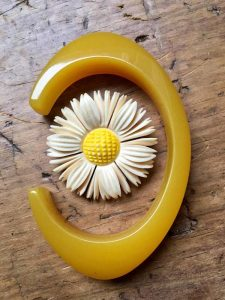Bakelite oval yellow bangle 1930s with carved bone brooch, author's collection